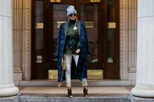 NEW YORK, NY - FEBRUARY 12: Nina Suess wearing a navy checked coat, grey beanie, white pants, heels on February 12, 2017 in New York City. (Photo by Christian Vierig/Getty Images)