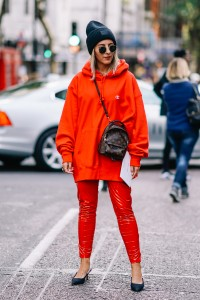 LONDON, ENGLAND - SEPTEMBER 17:  Aylin Koenig wears a black beanie hat, sunglasses, a red hoodie, a Vuitton bag, red plastic pants, outside Topshop, during London Fashion Week September 2017 on September 17, 2017 in London, England.  (Photo by Edward Berthelot/Getty Images)